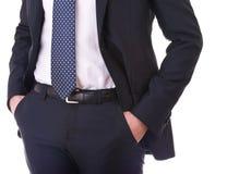 Manos del hombre de negocios en bolsillos. Fotografía de archivo libre de regalías