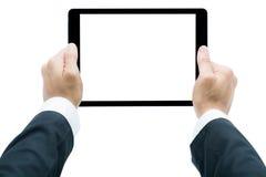 Manos del hombre de negocios que sostienen la tableta aislada imagen de archivo