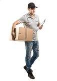 Manos del mensajero de las cajas, paquetes Imagen de archivo libre de regalías