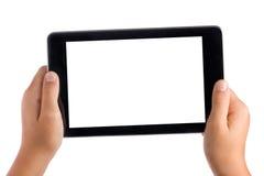 Manos del niño que sostienen la PC de la tableta Fotos de archivo libres de regalías