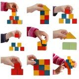 Manos del niño que juegan con collage coloreado de los bloques Fotos de archivo