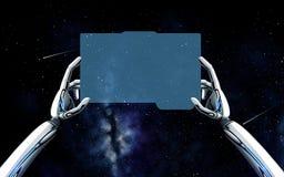 Manos del robot con PC de la tableta sobre fondo del espacio Fotos de archivo libres de regalías