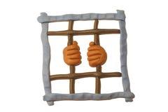 Manos en barras de la prisión Foto de archivo libre de regalías