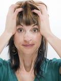 Manos en el pelo Imagen de archivo libre de regalías