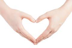 Manos en la dimensión de una variable del corazón Foto de archivo libre de regalías