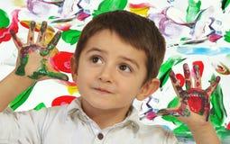 Manos en pintura Fotos de archivo libres de regalías