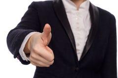 Manos en un traje de negocios que da el tacto encendido Imagen de archivo