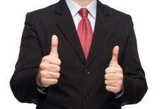 Manos en un traje de negocios que muestra los pulgares para arriba Imagen de archivo libre de regalías