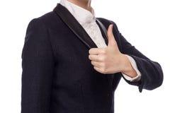 Manos en un traje de negocios que muestra los pulgares para arriba Fotos de archivo