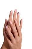Manos femeninas con la manicura imagenes de archivo