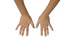 Manos femeninas con la manicura colorida aislada en el fondo blanco Imagen de archivo libre de regalías