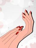 Manos femeninas con la manicura roja Imagen de archivo libre de regalías