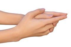Manos femeninas con los fingeres entrelazados - un gesto del rezo Foto de archivo libre de regalías
