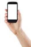 Manos femeninas que sostienen el teléfono móvil con la pantalla aislada y la tarjeta de crédito en blanco del negocio aisladas en Fotos de archivo libres de regalías