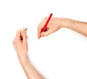 Manos humanas con el lápiz y el caucho del borrado fotografía de archivo
