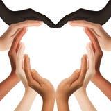 Manos humanas multirraciales que hacen una dimensión de una variable del corazón Imágenes de archivo libres de regalías