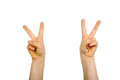 Manos levantadas con la muestra de paz Imagen de archivo libre de regalías