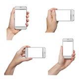 Manos masculinas aisladas que sostienen un teléfono blanco fotos de archivo
