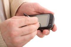 Manos masculinas con el PDA imágenes de archivo libres de regalías