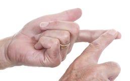Manos masculinas que gesticulan para hacer una punta Fotografía de archivo libre de regalías