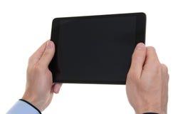 Manos masculinas que sostienen una tableta Foto de archivo