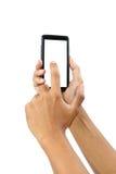 Manos masculinas que tocan en el smartphone móvil aislado con el recortes Imagen de archivo libre de regalías