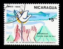 Manos, paloma de la paz, 9no aniversario del Sandinista Revoluti Imagenes de archivo