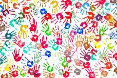 Manos pintadas blancas que recorren Imagen de archivo