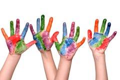 Manos pintadas de los niños Foto de archivo