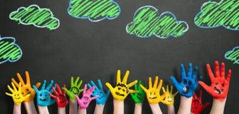 Manos pintadas de los niños Foto de archivo libre de regalías