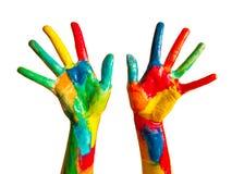 Manos pintadas, diversión colorida. Aislado Imagen de archivo