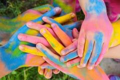Manos pintadas en diversos colores Imagen de archivo
