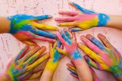 Manos pintadas en diversos colores Imágenes de archivo libres de regalías
