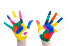 Manos pintadas en pinturas coloridas imagen de archivo