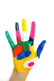 Manos pintadas en pinturas coloridas Fotografía de archivo