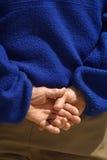 Manos plegables detrás. 2 imagen de archivo libre de regalías