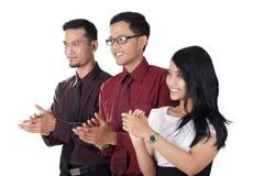 Manos que aplauden del equipo asiático del negocio Imagen de archivo