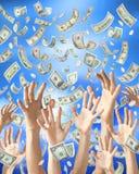 Manos que cogen lloviendo el dinero Imágenes de archivo libres de regalías
