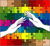 Manos que cuidan en rompecabezas colorido Imagenes de archivo
