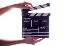 Manos que llevan a cabo concepto del tablero de chapaleta o de la película de la pizarra Fotografía de archivo libre de regalías