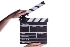Manos que llevan a cabo concepto del tablero de chapaleta o de la película de la pizarra Imagenes de archivo