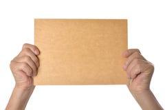 Manos que llevan a cabo el espacio en blanco Imagen de archivo libre de regalías
