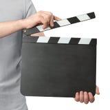 Manos que llevan a cabo el tablero de chapaleta aislado en el fondo blanco Fotografía de archivo libre de regalías