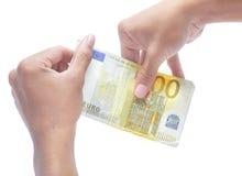 Manos que llevan a cabo la nota del euro del valor cero Fotos de archivo libres de regalías