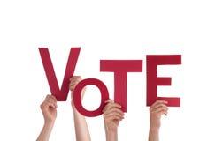 Manos que llevan a cabo voto fotografía de archivo