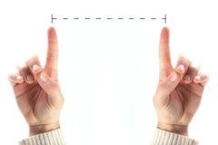 Manos que miden foto de archivo