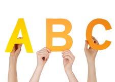 Manos que sostienen ABC Fotos de archivo
