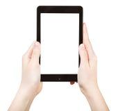 Manos que sostienen el panel táctil con la pantalla cortada Fotos de archivo libres de regalías