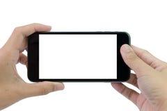Manos que sostienen el teléfono elegante imágenes de archivo libres de regalías