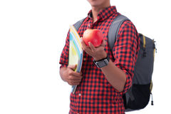 Manos que sostienen la manzana roja con el libro, aislado en blanco Imágenes de archivo libres de regalías